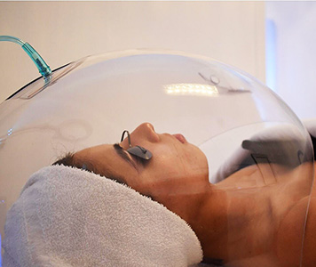 Client Getting Oxygen Dome Therapy at Face of Jules Los Angeles Facial Spa